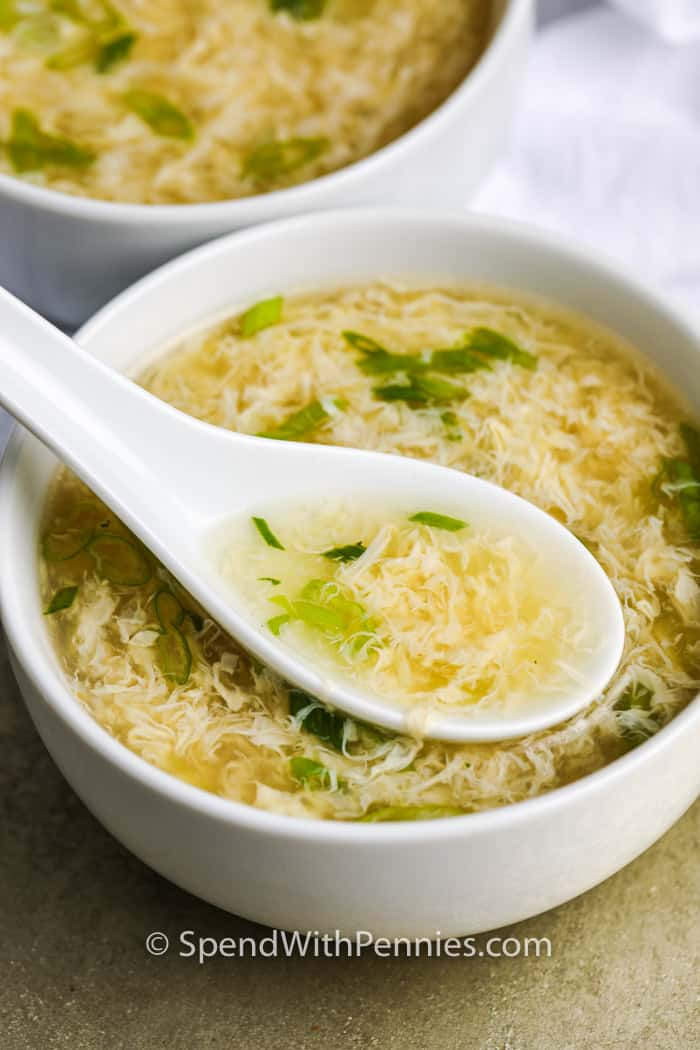 Egg Drop Soup in a white bowl and a white spoon inside