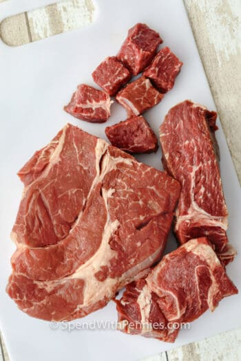beef on a cutting board to make Stew Meat