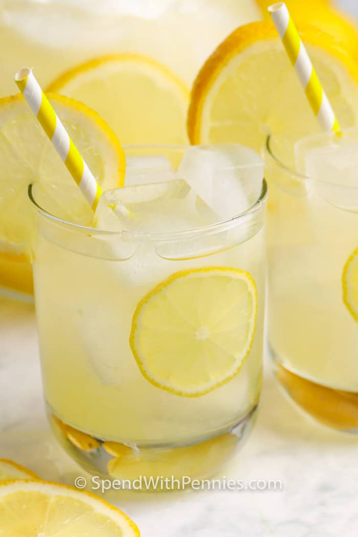 close up of 2 glasses of Homemade Lemonade with lemon garnish and ice