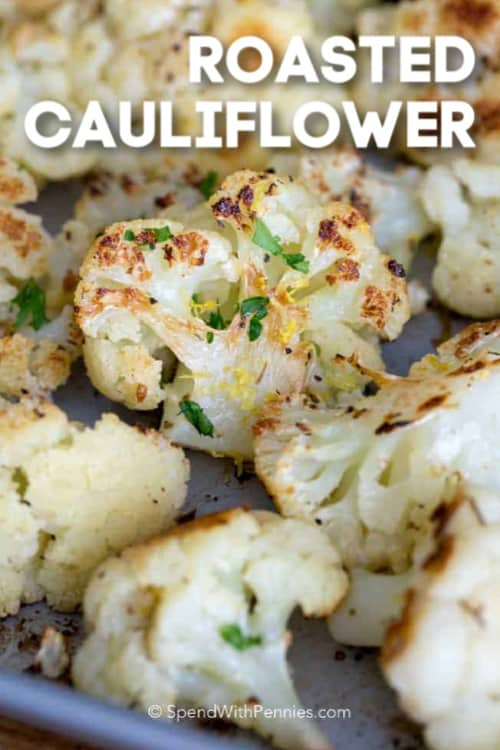Perfectly browned roasted cauliflower topped with parsley and fresh from the oven with a title