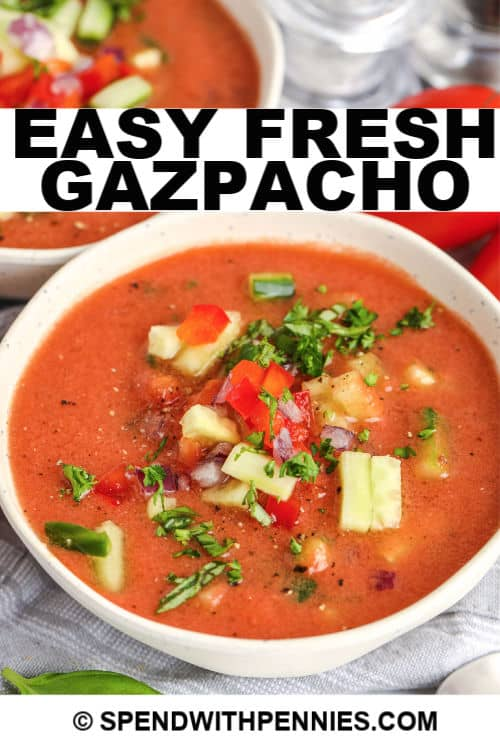 A bowl of Gazpacho with writing