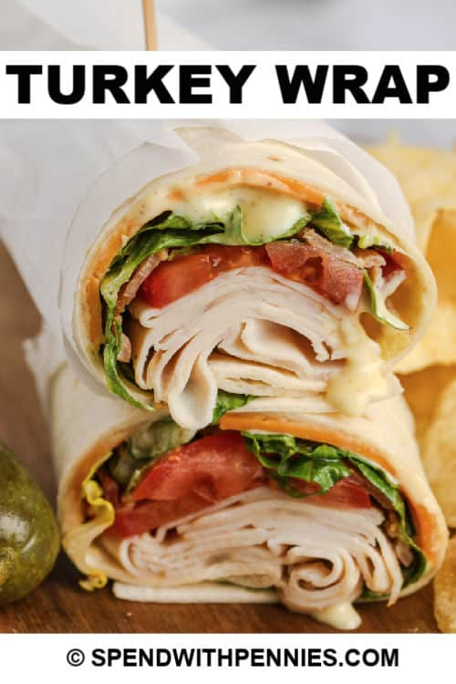 Turkey Wrap cut in a half and stacked on eachother with writing