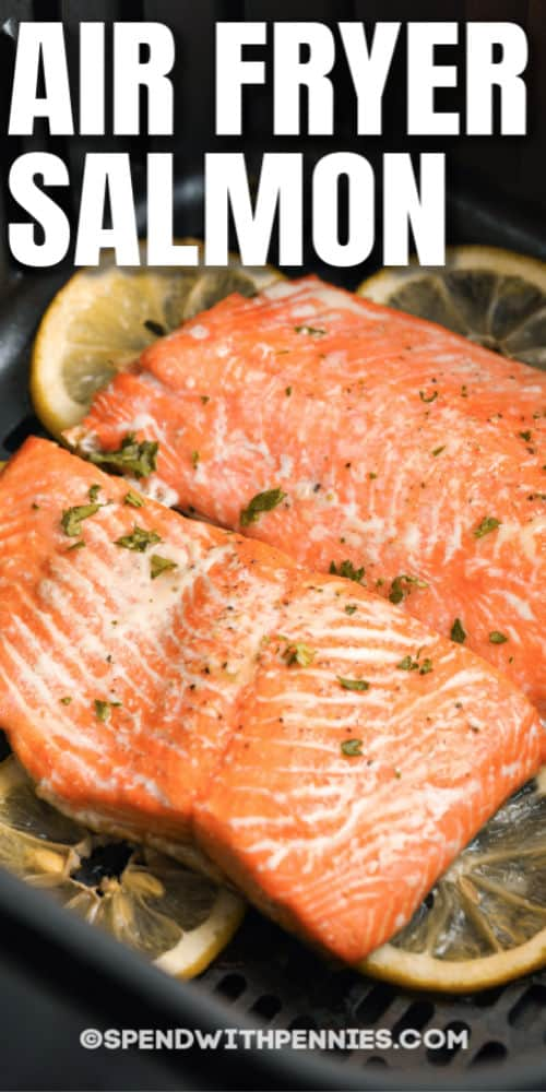 close up of Air Fryer Salmon in the air fryer with writing