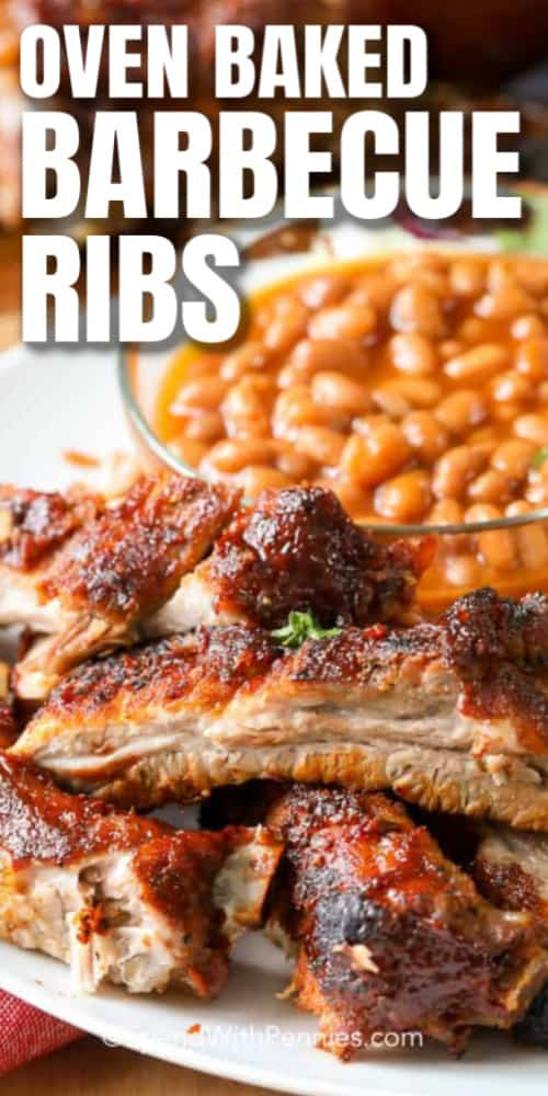 A plate of Barbecue Ribs with a side of baked beans with a title.