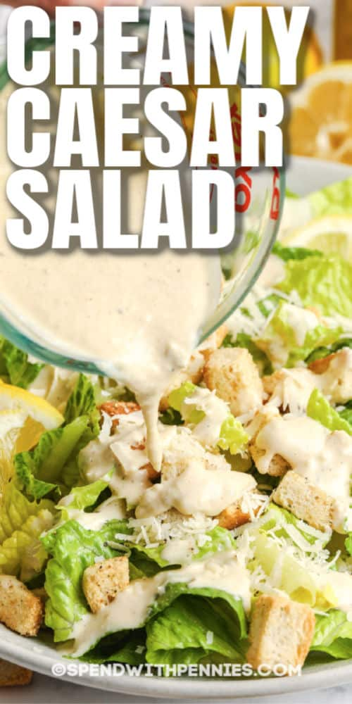 pouring dressing on Caesar Salad with writing
