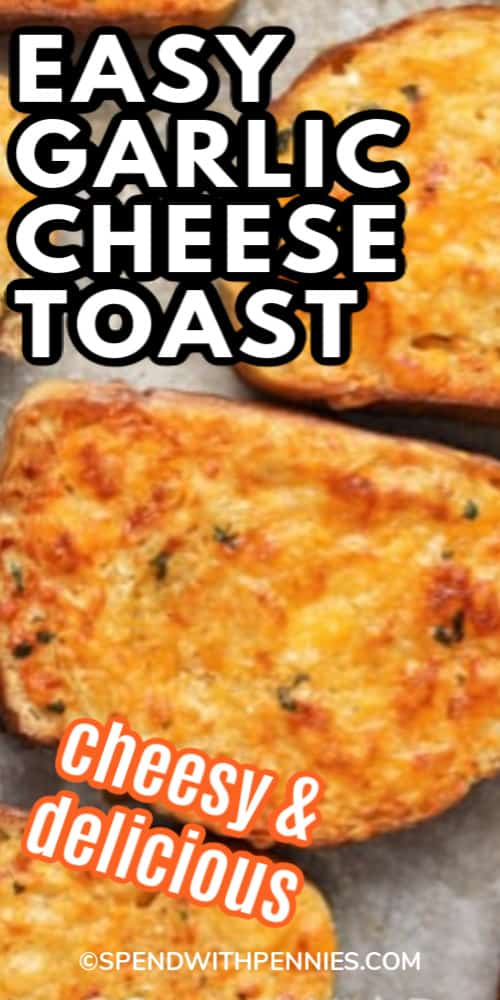 Slices of Garlic Cheese Toast on a baking sheet with writing.