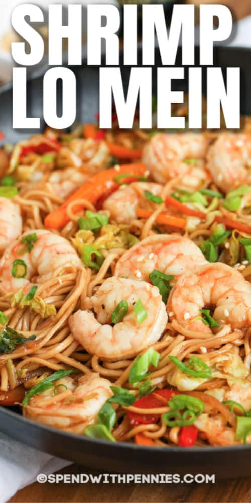 Shrimp Lo Mein in a frying pan with writing
