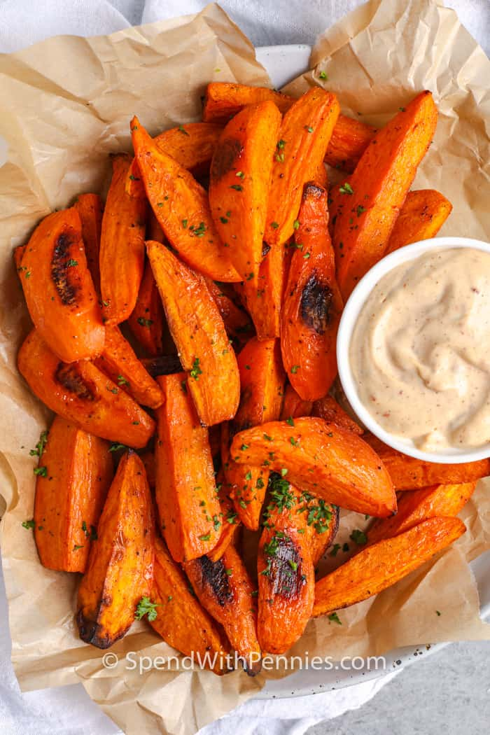 top view of Sweet Potato Wedges in a basket with dip