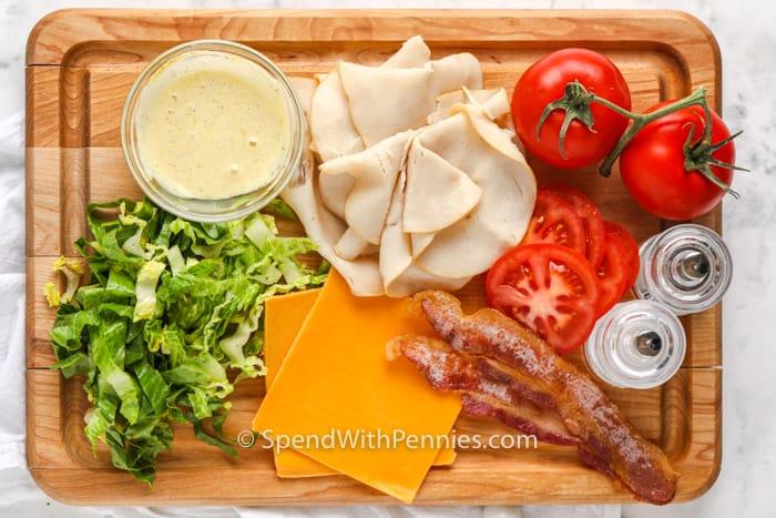 ingredients to make Turkey Wrap on a cutting board