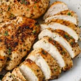 Air Fryer Chicken Breasts on a plate with garnish