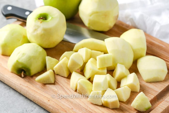 Apples on a cutting board to make Apple Crumble