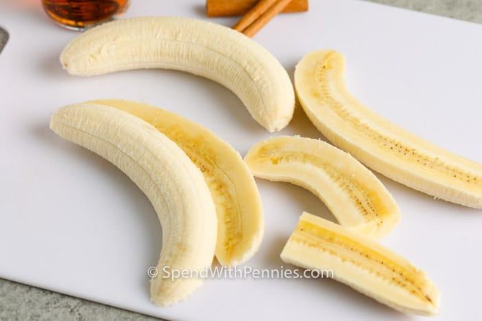 cutting bananas on cutting board to make Banana Foster