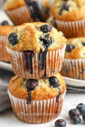 two Blueberry Banana Muffins stacked on top of eachother