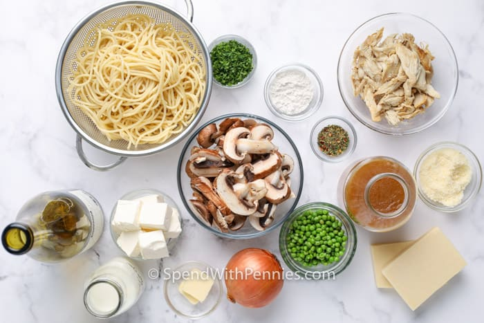 ingredients in bowls to make Chicken Tetrazzini on a marble table