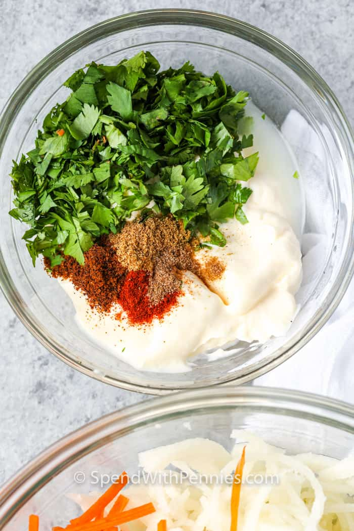 ingredients to make Cilantro Lime Coleslaw in glass bowls
