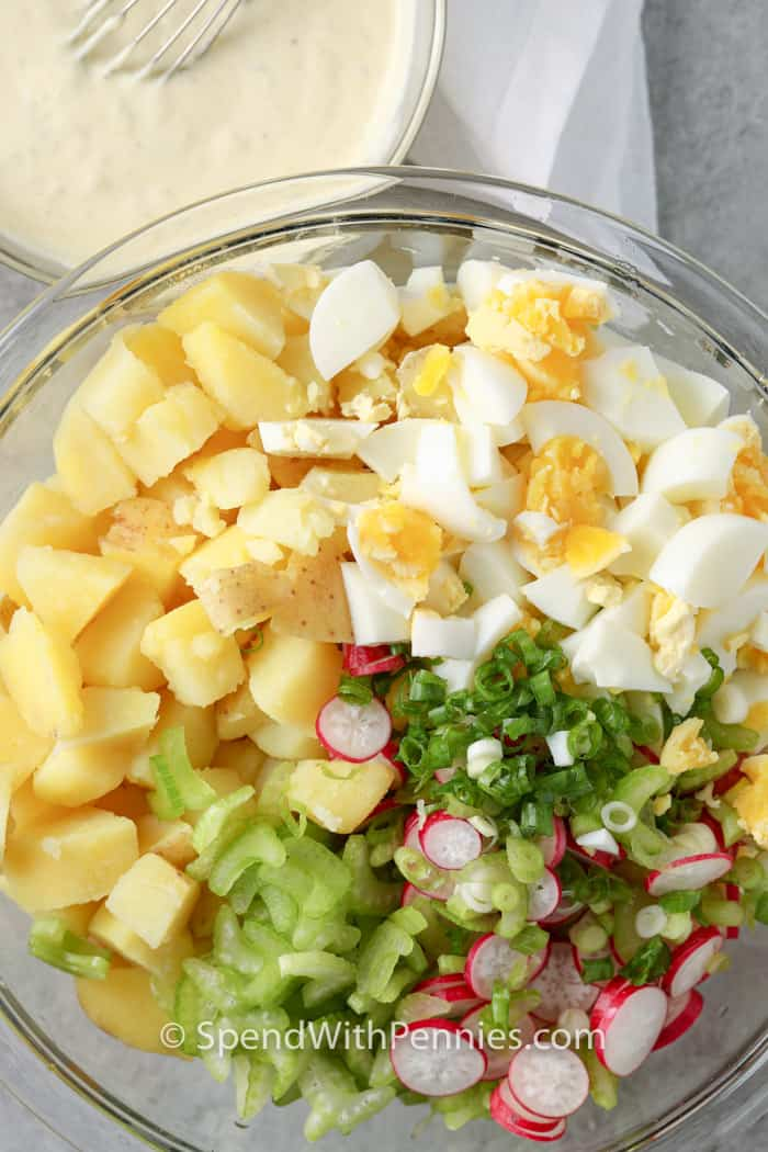 ingredients to make a Classic Potato Salad in a glass bowl