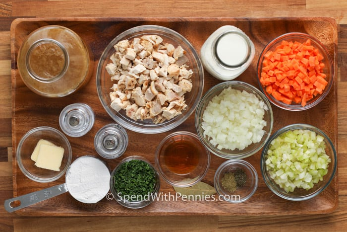 ingredients on a wooden board to make Cream of Chicken Soup