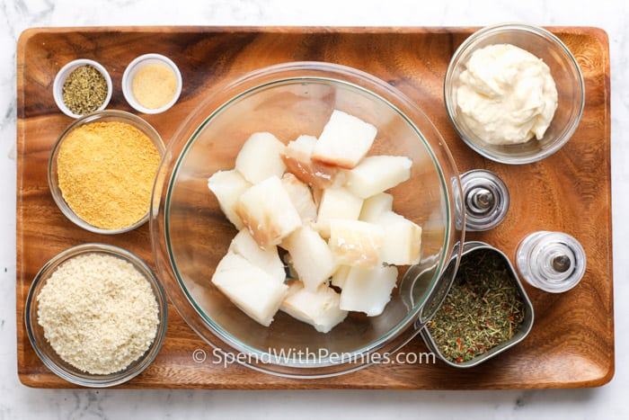ingredients on a wooden board to make Fish nuggets