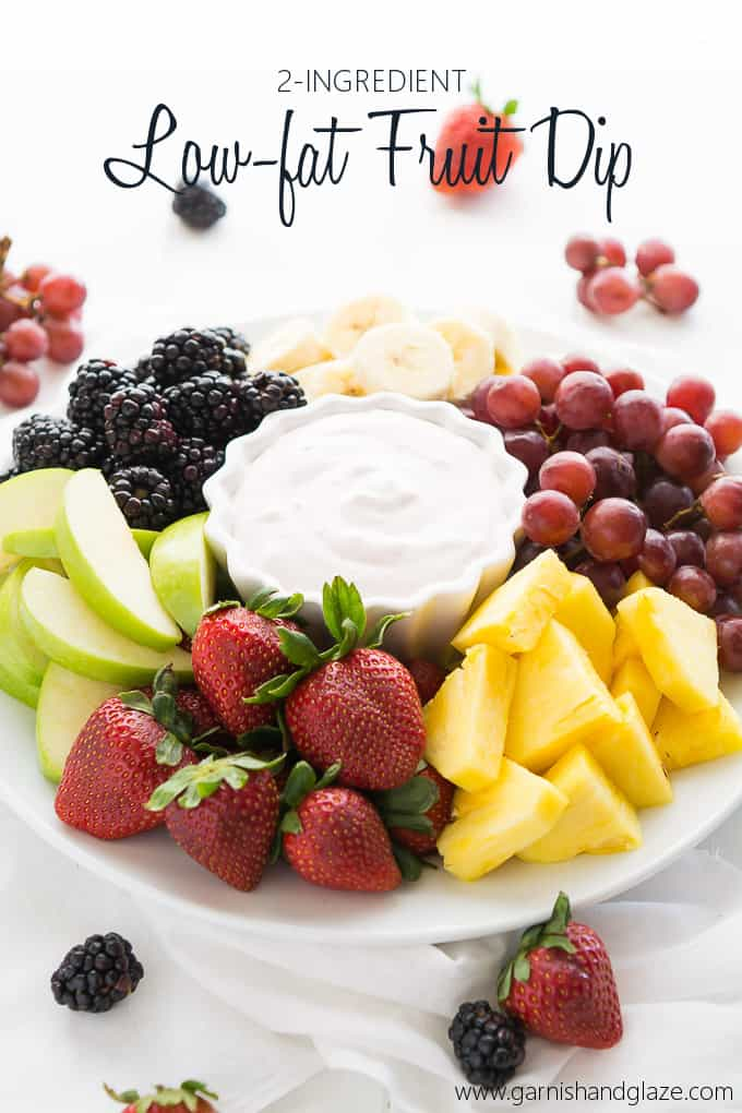 Fruit dip with fruit on a plate with writing