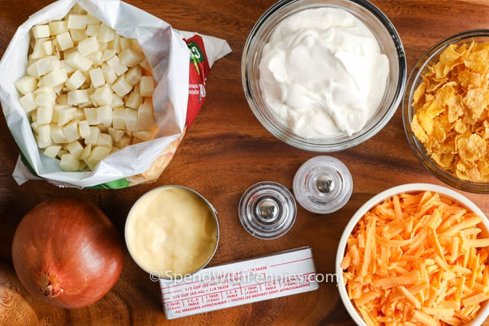 ingredients to make Funeral Potatoes on a wooden board