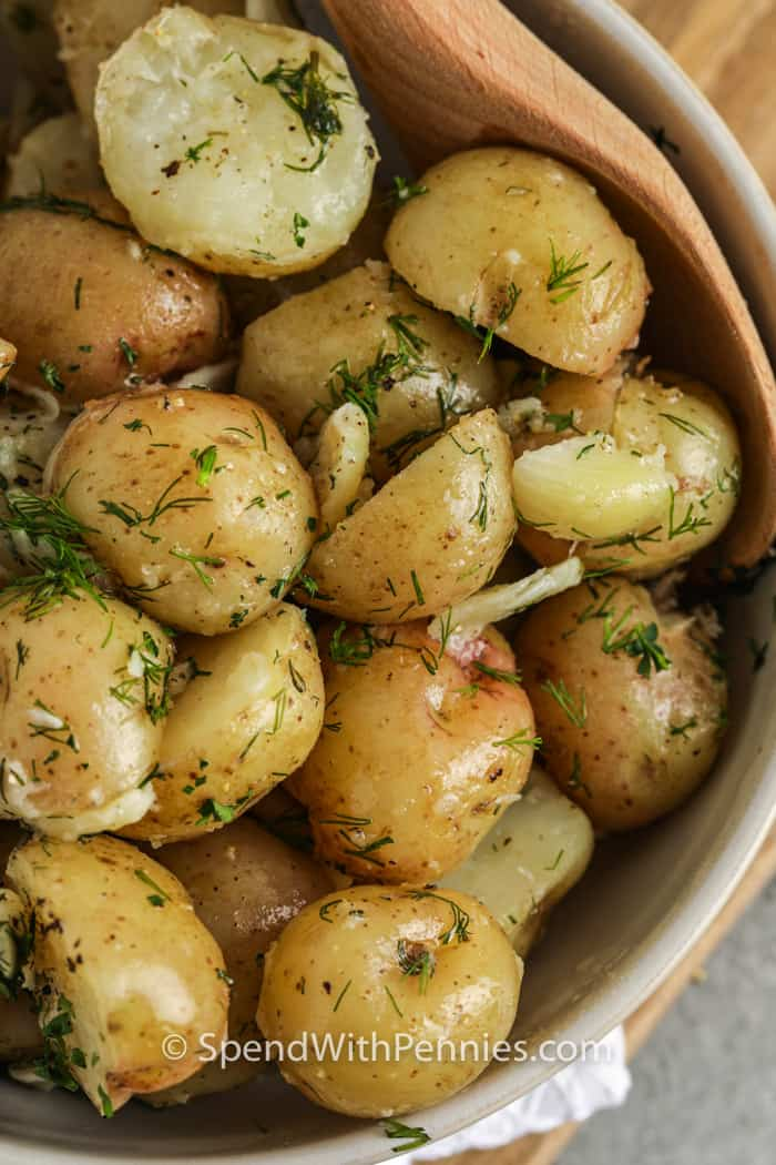 top view of Garlic Dill New Potatoes in a bowl with a spoon
