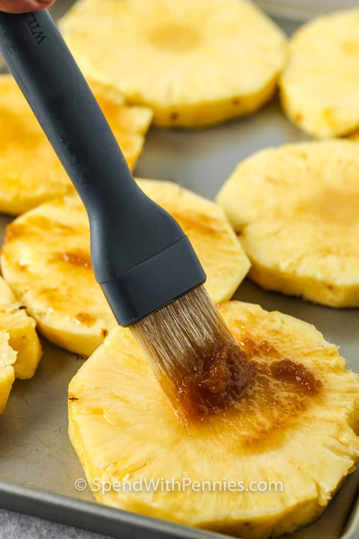 brushing sauce on Grilled Pineapple