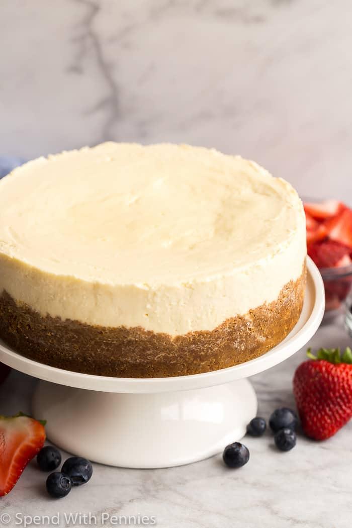 instant pot cheesecake on white cake plate plain