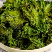 a bowl of cooked kale chips