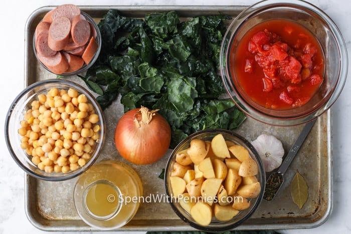 ingredients to make Kale Soup on a metal sheet