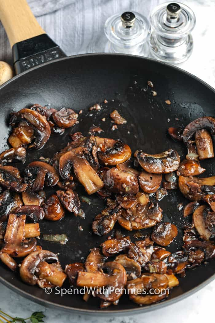 mushrooms in a pan to make Mushroom Gravy