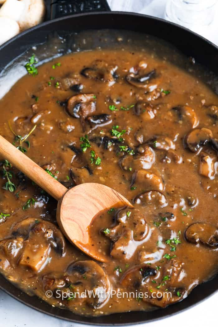 wooden spoon mixing Mushroom Gravy