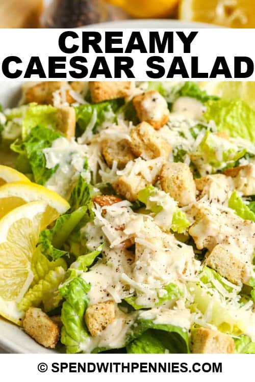 Caesar Salad with lemons on the side, with writing