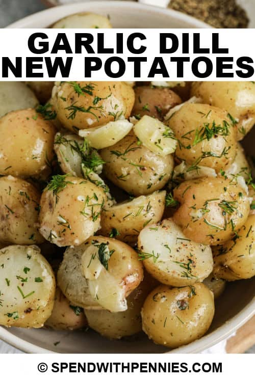 close up of Garlic Dill New Potatoes cooked in a white bowl with writing