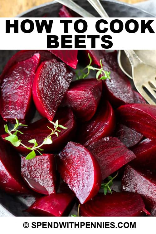 Cooked beets in a dish with a silver fork and writing