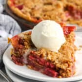 Rhubarb Pie on a plate with ice cream