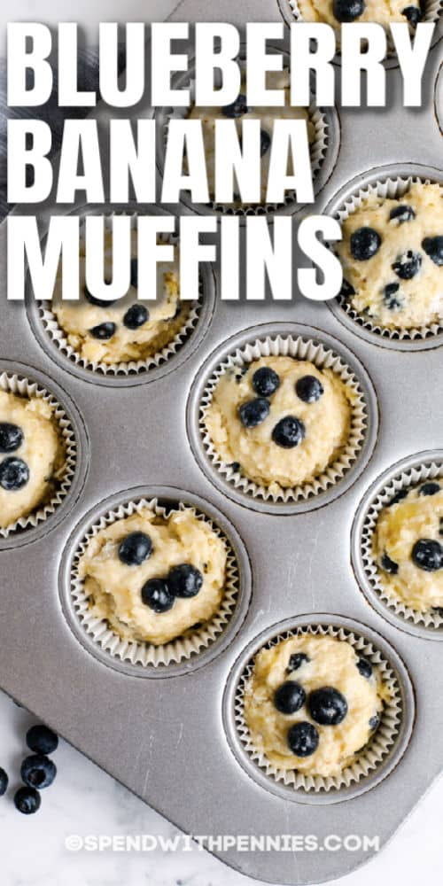 Blueberry Banana Muffins in a baking sheet before cooking with writing