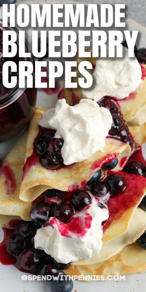 top view of Blueberry Crepes on a plate with writing