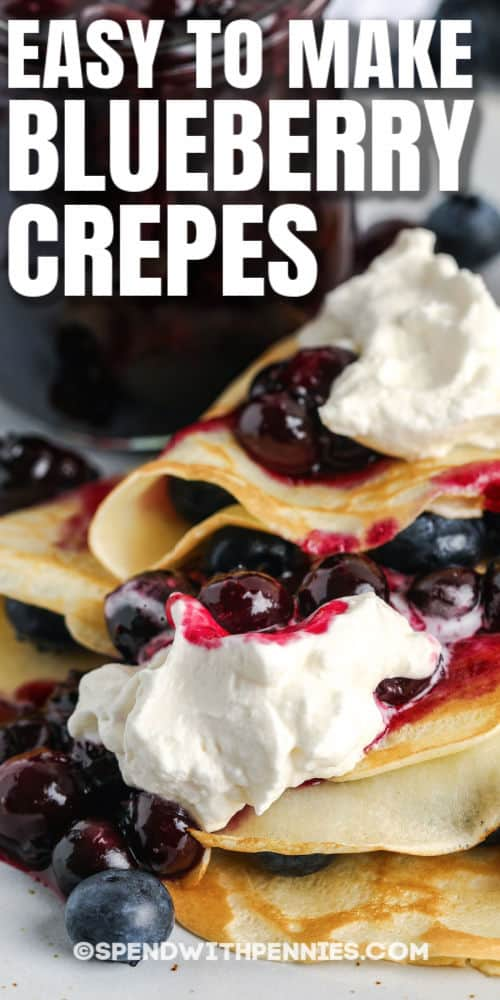 close up of Blueberry Crepes with blueberry jar in the background and a title