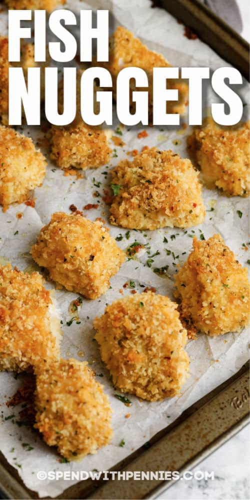 close up of Fish Bites (Fish Nuggets) on a baking sheet with writing