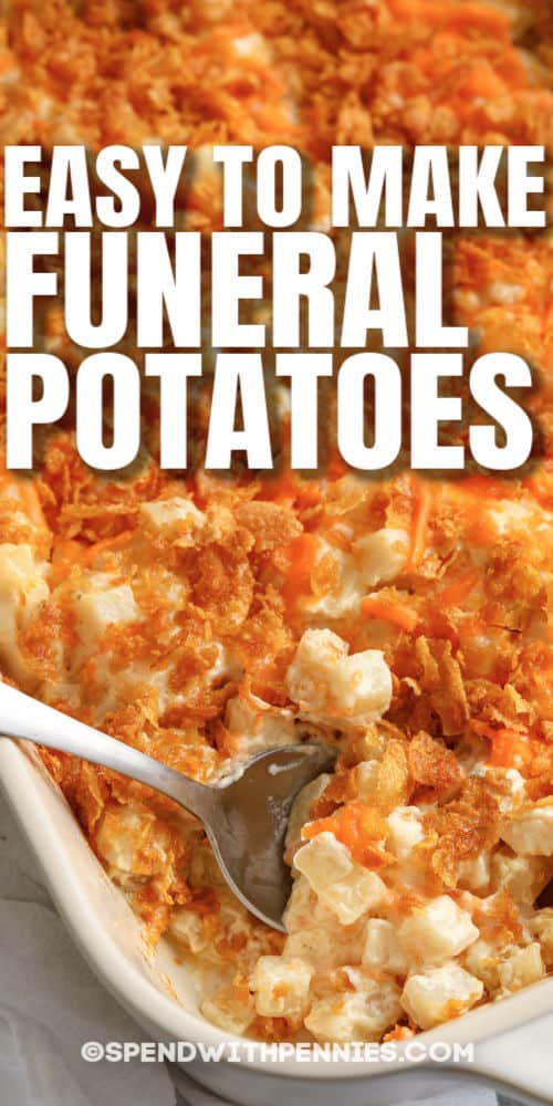 Funeral Potatoes in a casserole dish with a spoon and writing
