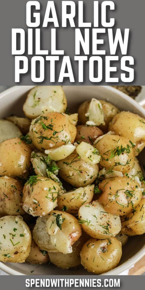 cooked Garlic Dill New Potatoes in a white bowl with writing and title