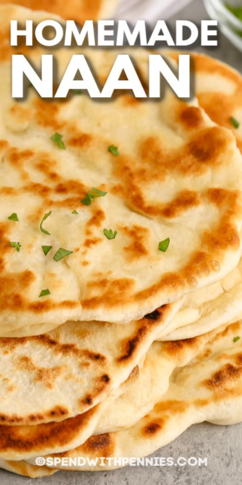 A stack of homemade naan bread with writing