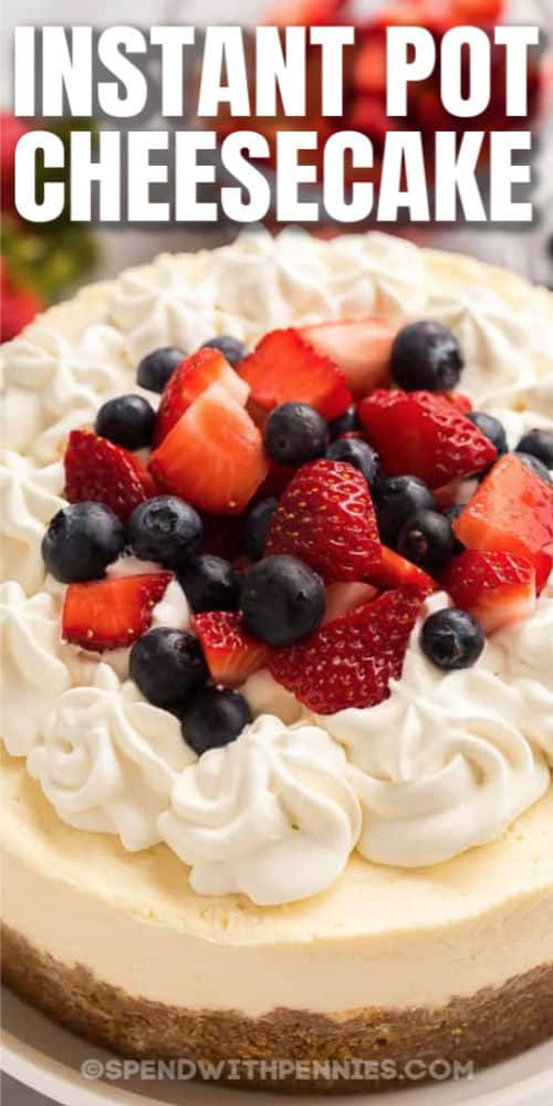 close up on fruit , whipped cream on Instant Pot Cheesecake with writing