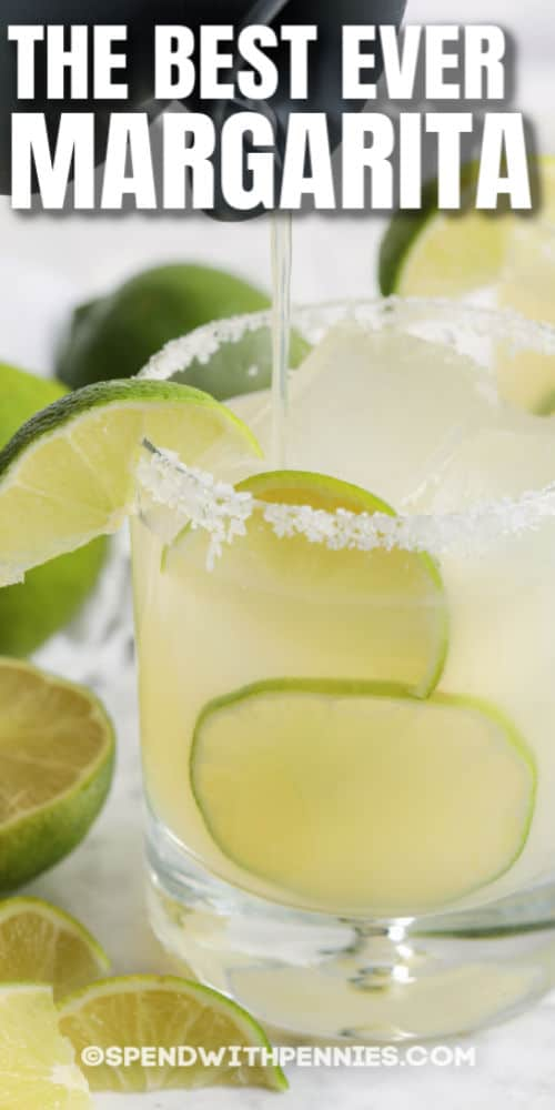 pouring Margarita in a glass with writing