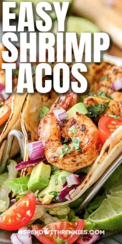 close up of Shrimp tacos with writing