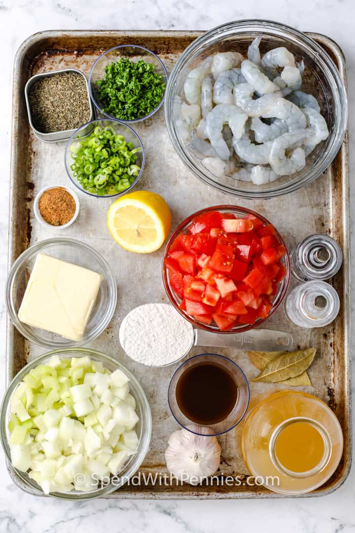 ingredients to make Shrimp Etouffee on a baking sheet