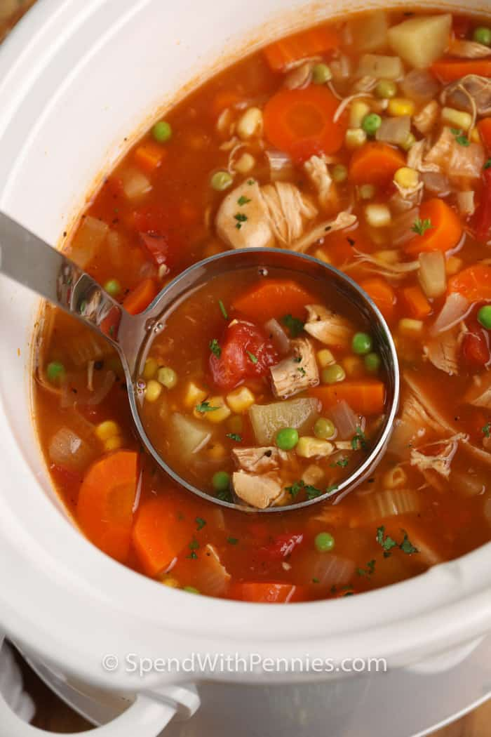 laddle of Slow Cooker Turkey Vegetable Soup in a slow cooker