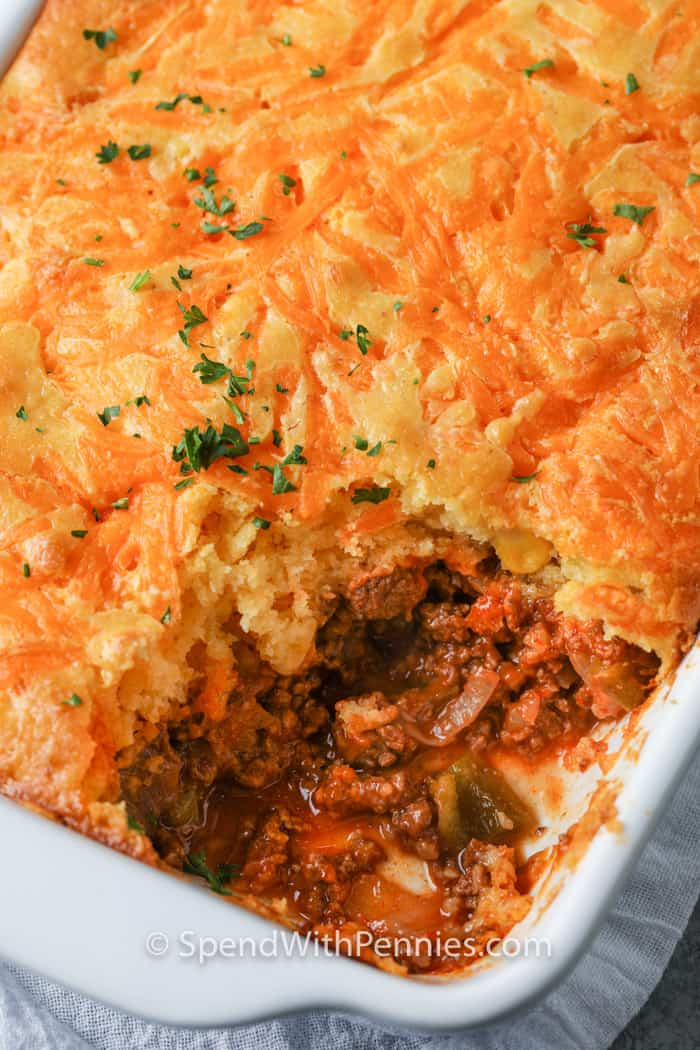 Tamale Pie in a casserole dish with a portion taken out