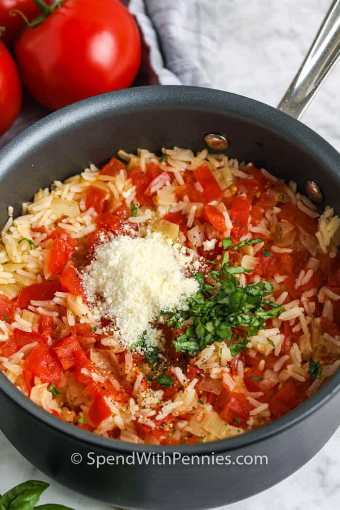 Tomato Basil Rice in a pot being cooked