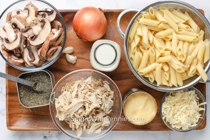 ingredients to make a Turkey Casserole on a wooden board